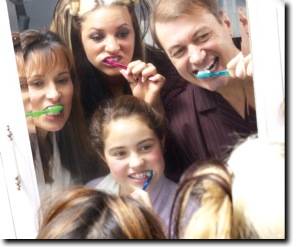 family-brushing-teethweb